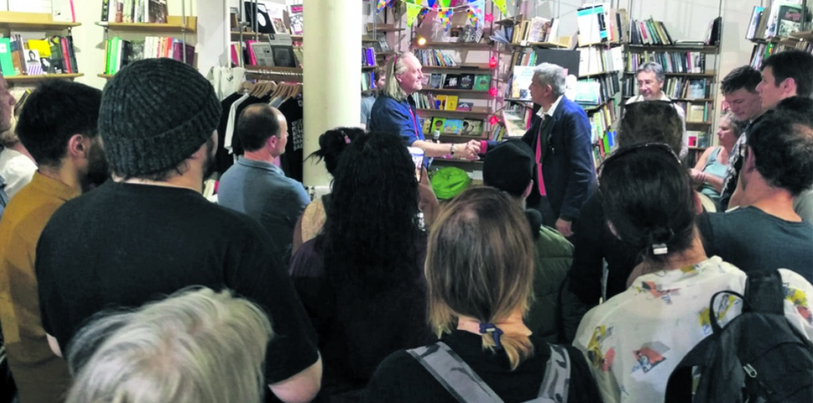 Bookmarks bookshop manager Dave Gilchrist shakes hands with London Assembly member Ushmen Desai at the protest against the neofascist attack