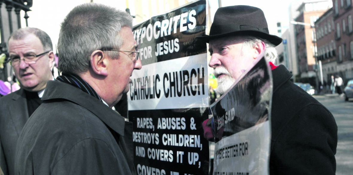 Irish Eamon Reid (right), abused by priests, confronts Archbishop Diamuid Martin at St Mary's Pro-Cathedral, Dublin