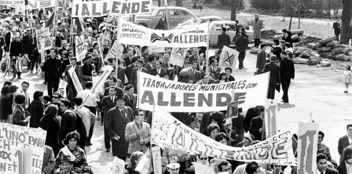 A crowd of people marching to support the election of Salvador Allende for president in Santiago, Chile, in 1964