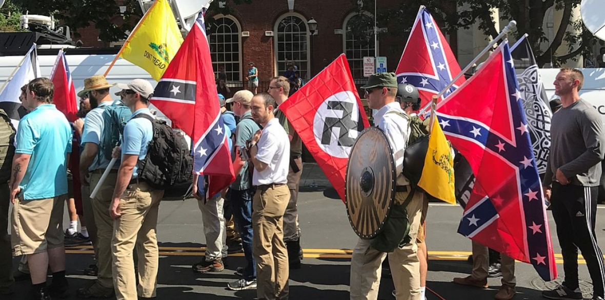 Alt-right members prepare to enter Emancipation Park, Charlottesville, USA holding nazi, Confederate, and 'Don't Tread on Me' flags in 2017