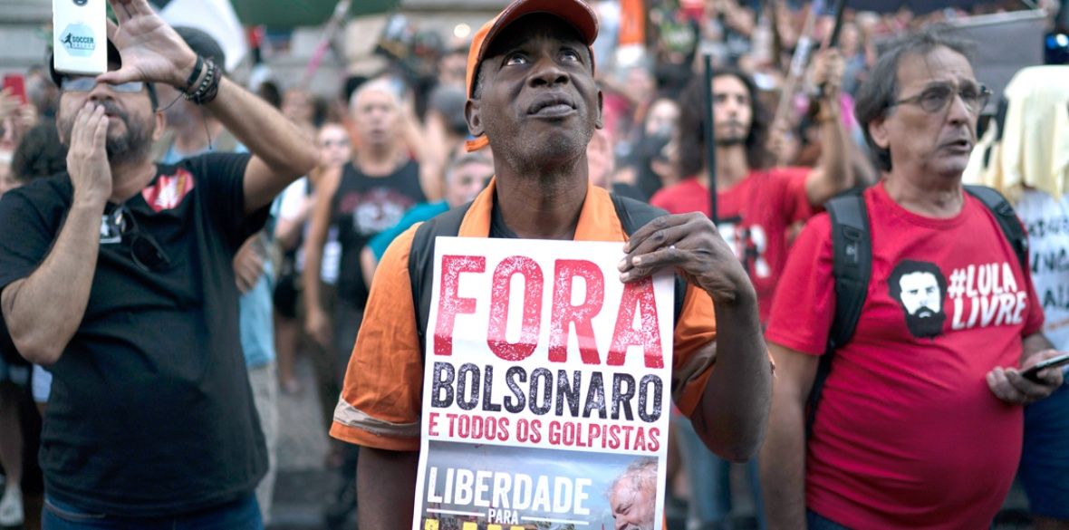 2725928af1c56 Freedom to Lula and all political prisoners — down with electoral fraud,'  reads the placard during a protest against the military coup of ...