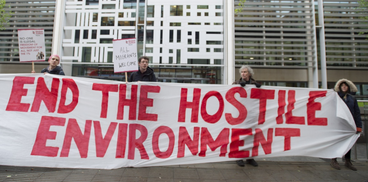 A protest against the B ritish Conservative government's hostile environment policies outside the Home Office in London Photo: Global Justice Now