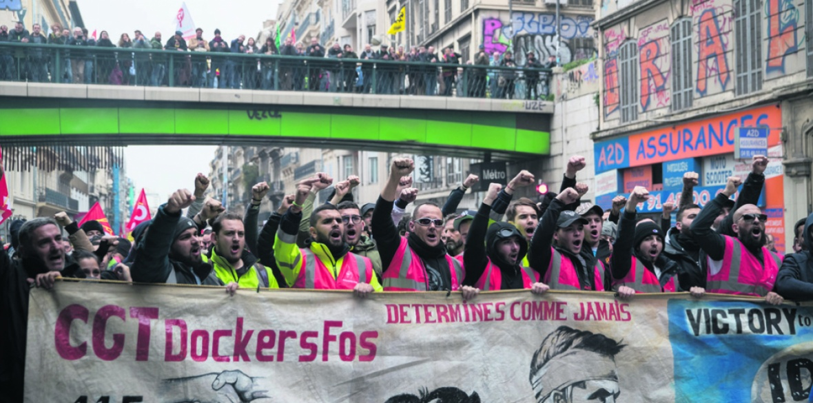 Dock workers and other trade unionists march in Marseille, France against Macron