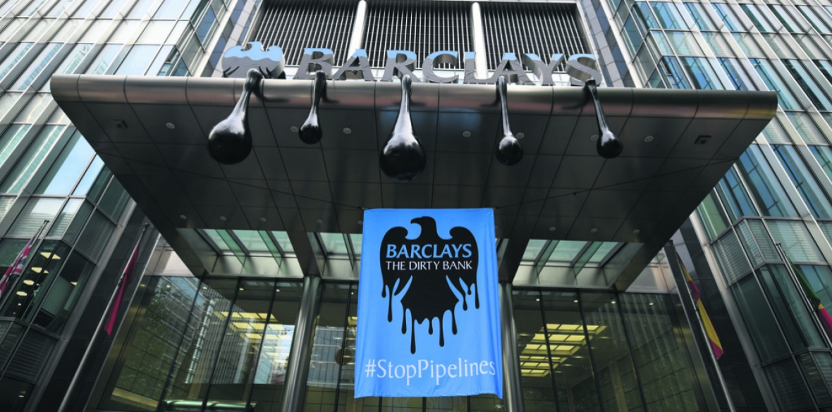 Anti-pollution banner on Barclays bank building.  Photo: © Chris J Ratcliffe / Greenpeace