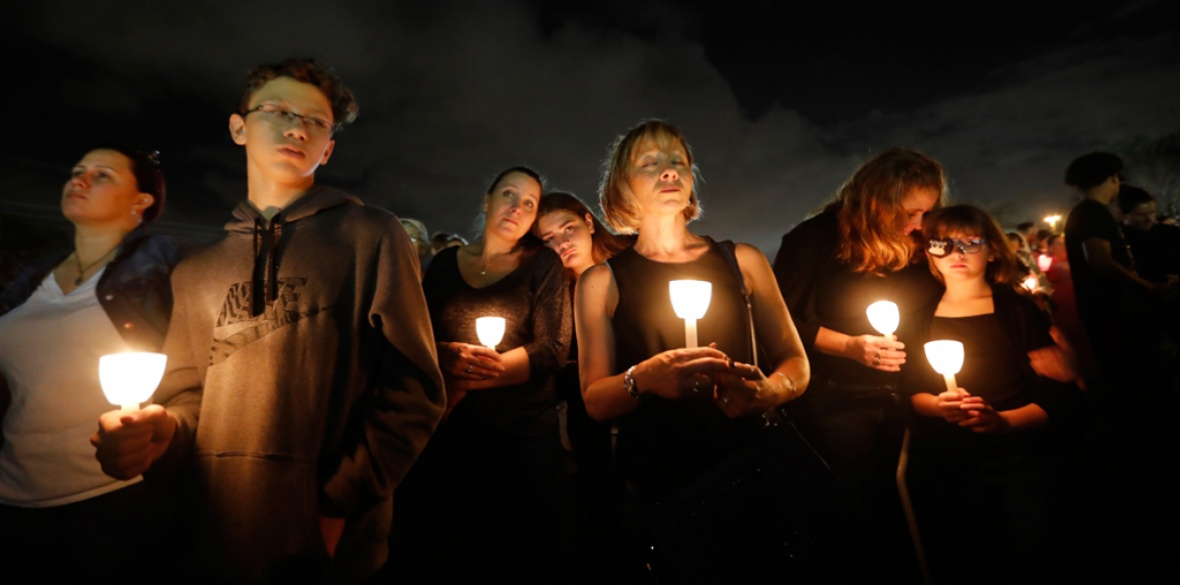 A candlelit vigil in memory of the 17 people killed in the mass shooting at Marjory Stoneman Douglas High School in Parkland, Florida