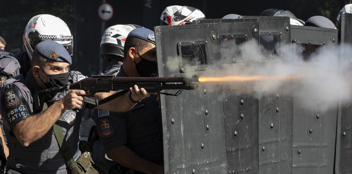 Violent: Police in Sao Paulo fire at anti-government protesters yesterday