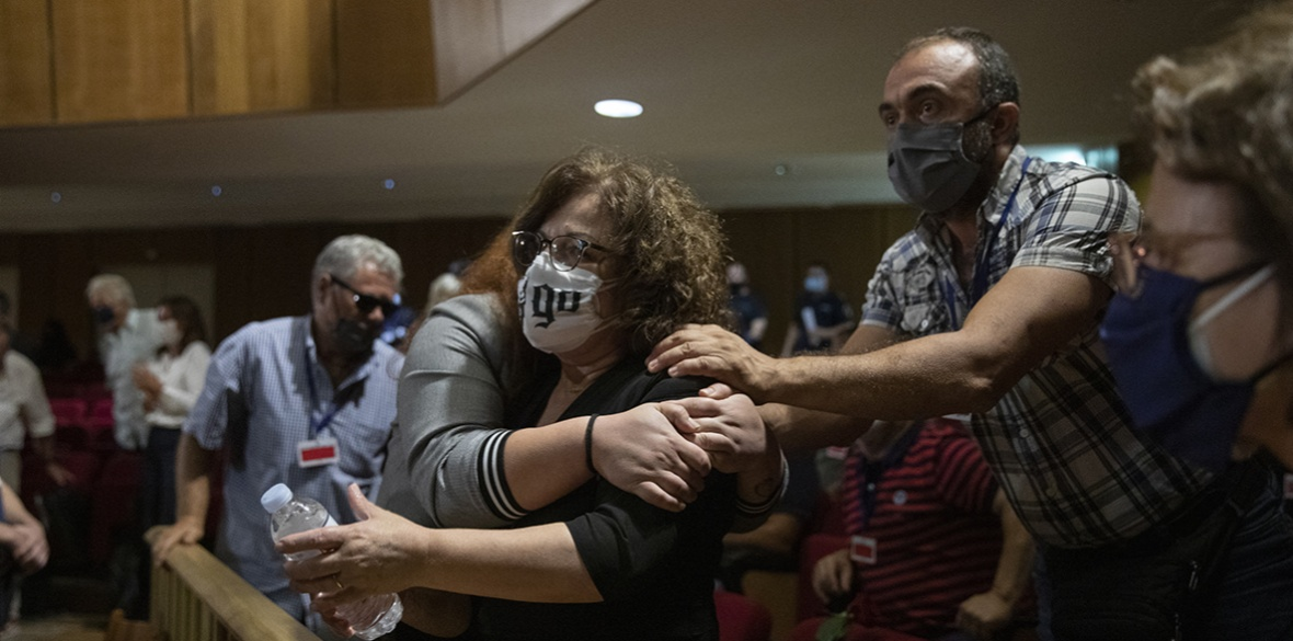 Magda Fyssa (centre) the mother of late Greek rap singer Pavlos Fyssas, who was stabbed and killed by a supporter of the extreme right Golden Dawn party in 2013 triggering a crackdown on the party, celebrates immediately after the delivery of the verdict of a court in Athens
