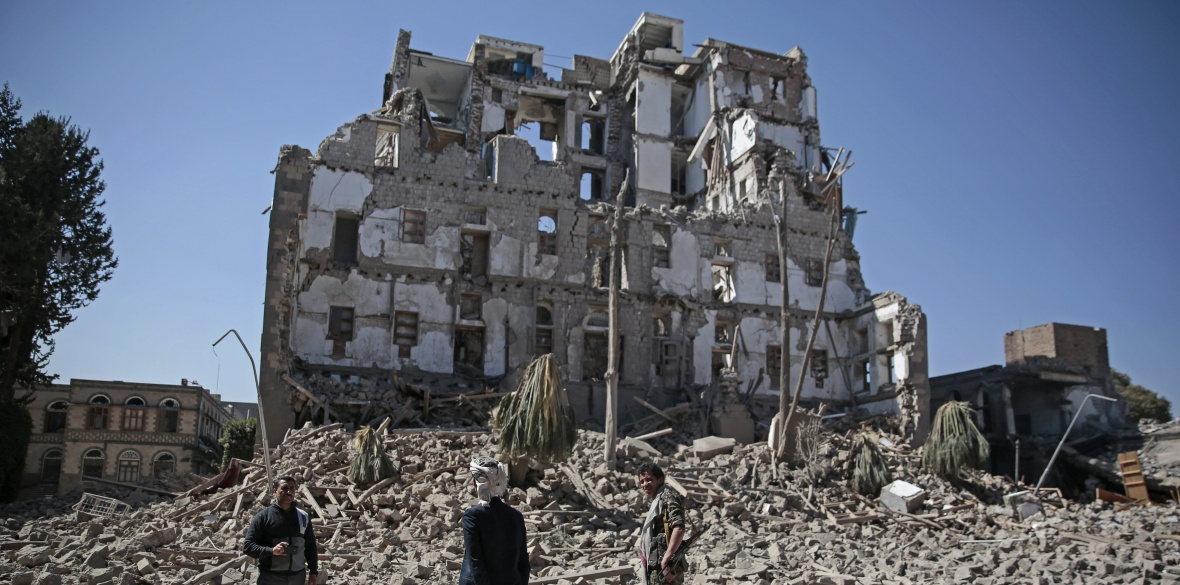 A Houthi fighter walks amid the rubble of the Republican Palace that was destroyed by Saudi-led airstrikes, in Sanaa, Yemen, on Wednesday December 6 2017