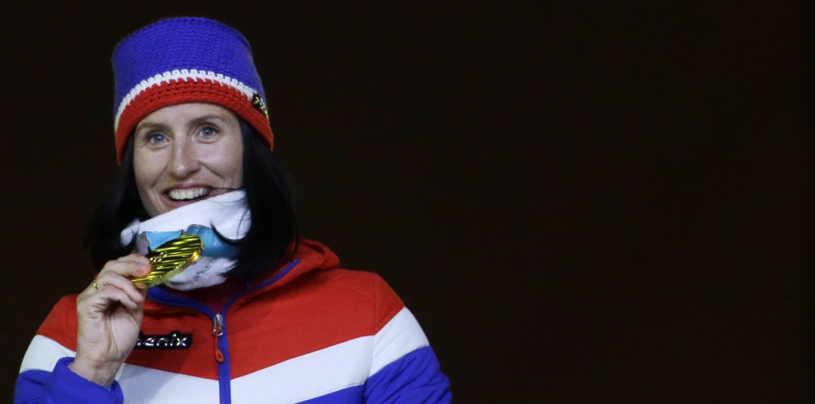 Norway's Marit Bjoergen, gold, poses for photos during the medals ceremony for the women's 30k cross-country skiing at the closing ceremony of the 2018 Winter Olympics in Pyeongchang, South Korea, Sunday, Feb. 25, 2018. (AP Photo/Natacha Pisarenko)
