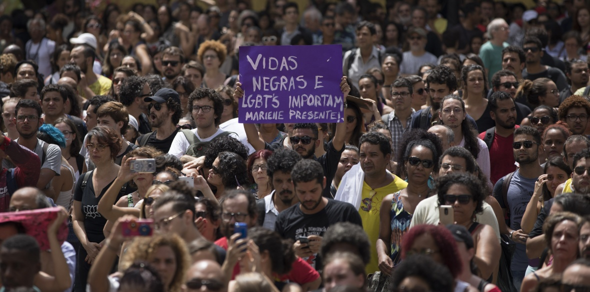 People rally in Rio de Janeiro in memory of murdered councillor Mariella Franco Photo: Leo Correa/AP Photo