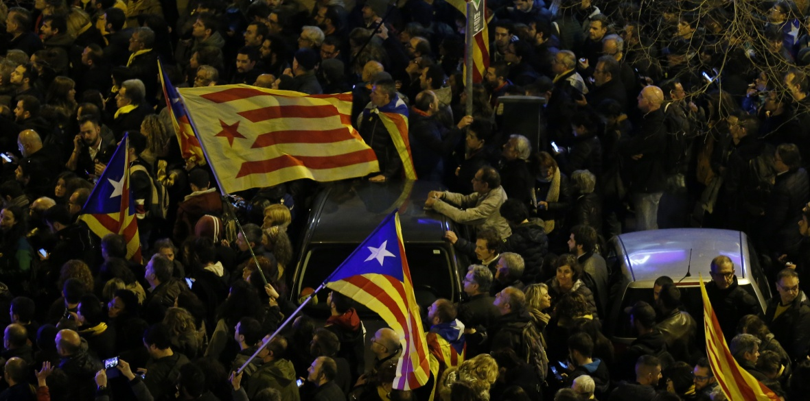 People protest in Barcelona on Friday March 23 against the jailing of Catalan separatist politicians