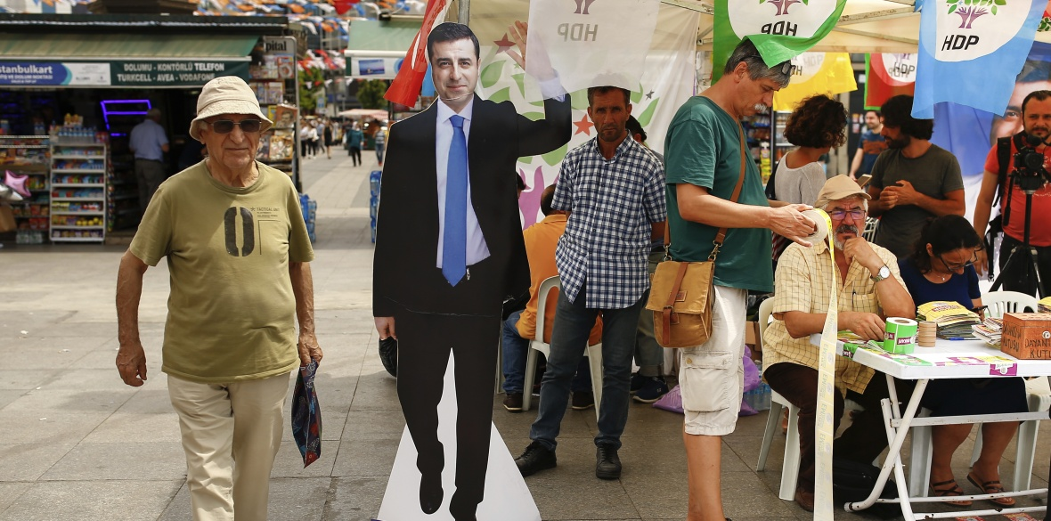 A cardboard cutout of HDP presidential candidate Selahattin Demirtas stands near a party election stall in Istanbul
