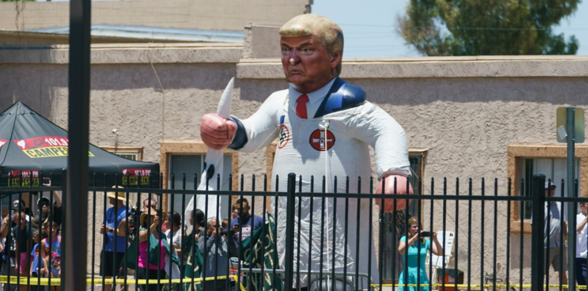 Protesters place a large inflatable balloon in the likeness of President Donald Trump dressed in a Ku Klux Klan sheet across the street from Southwest Key Campbell, a shelter for children that have been separated from their parents, in Phoenix, Arizona, last week