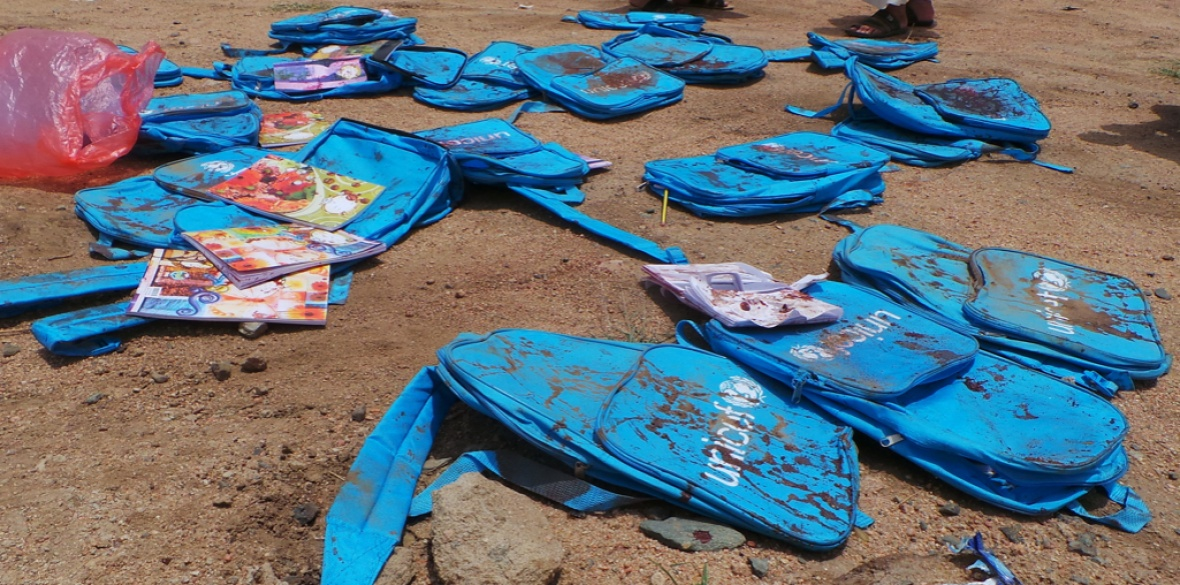Murdered Yemeni children's UNICEF backpacks lie at the site a day after a Royal Saudi Air Force airstrike in Saada, Yemen that killed dozens of people yesterday, including many children