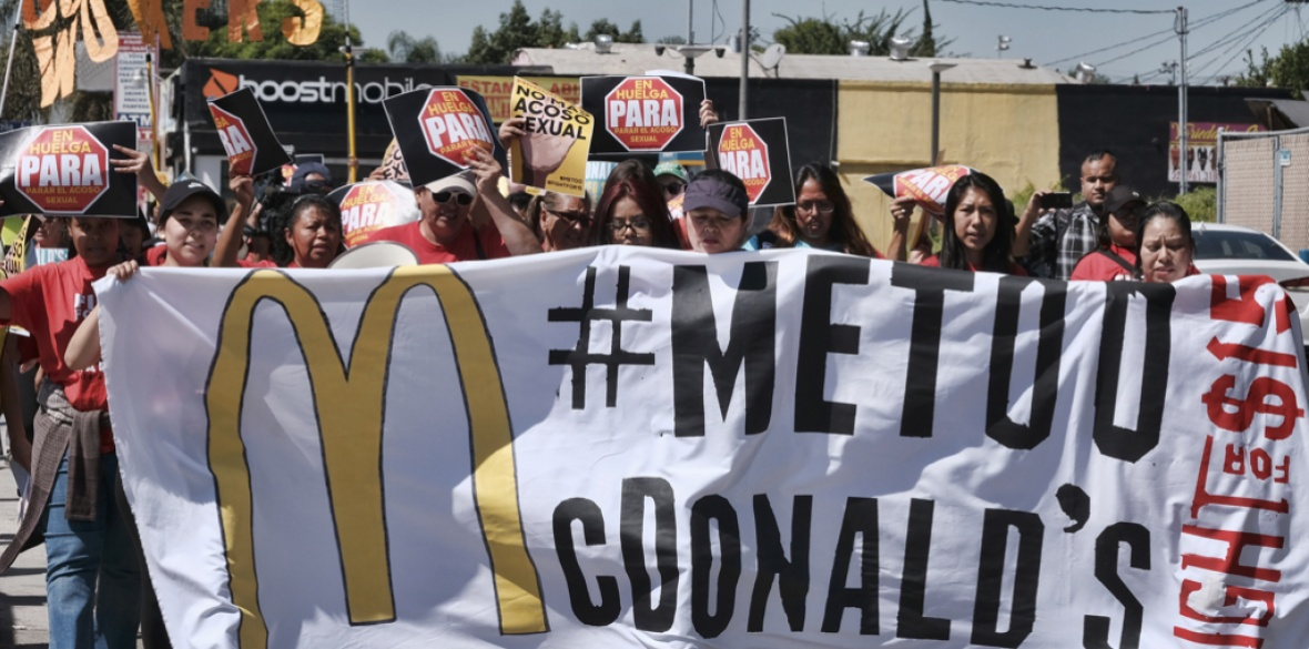 McDonald's workers carry a banner and march towards a McDonald's in south Los Angeles, USA