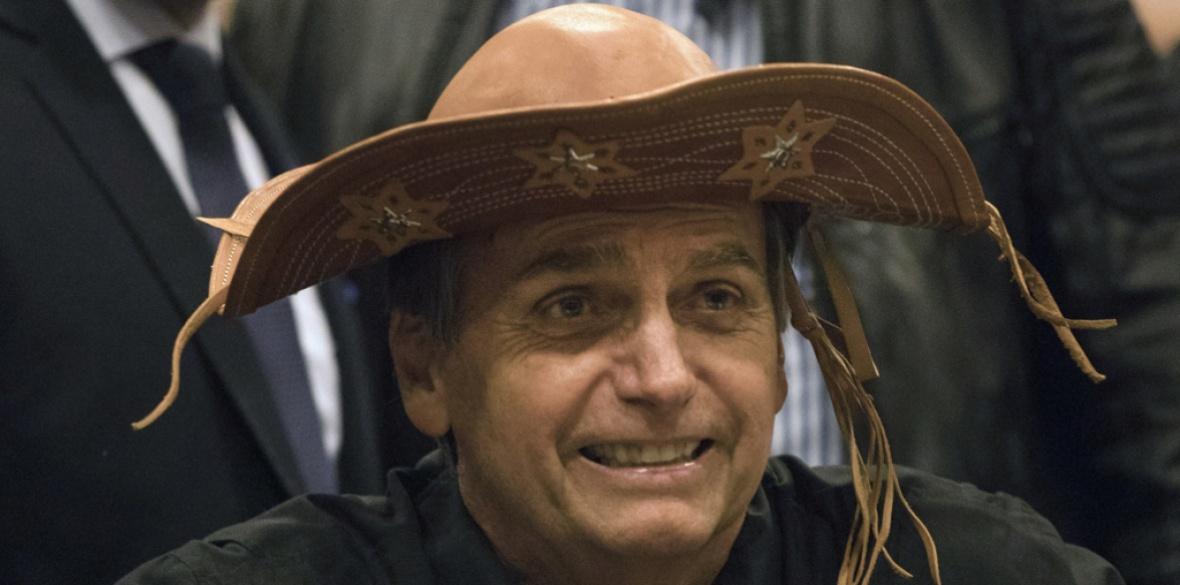Brazilian presidential candidate Jair Bolsonaro wears a traditional Brazilian  cowboy hat during a press conference in Rio de Janeiro 67ea2d580a6