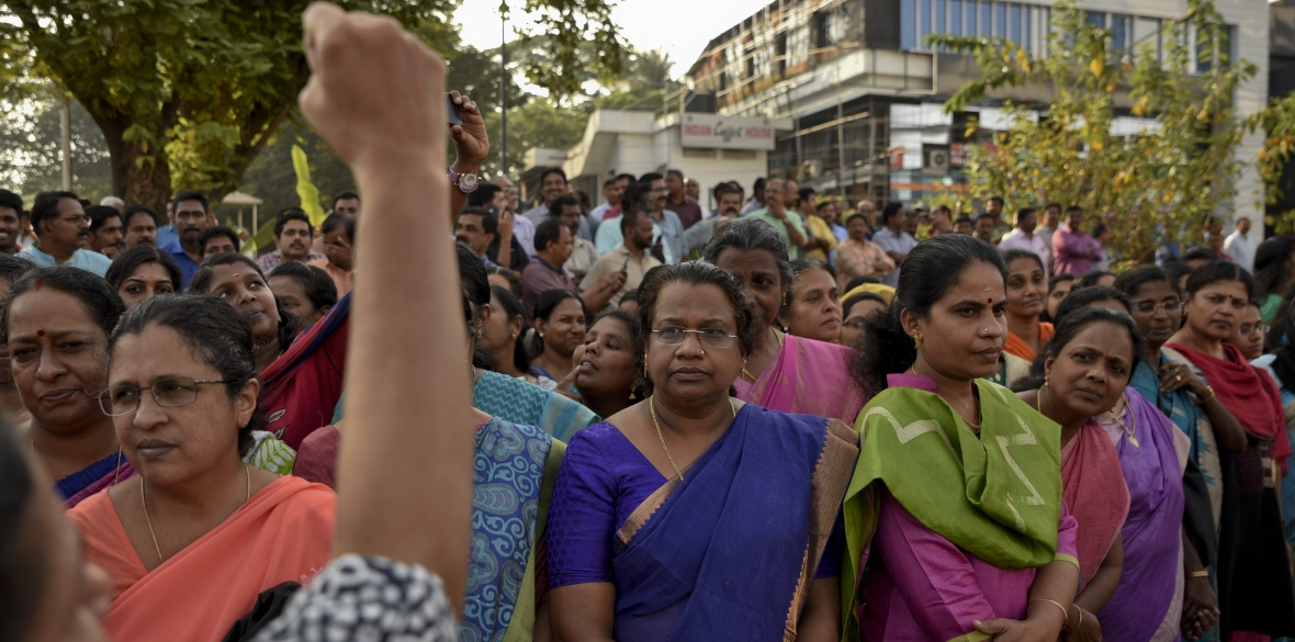 A woman shouts slogans against gender discrimination as they gather to form part of a hundreds kilometer long 'women's wall' in Thiruvananthapuram