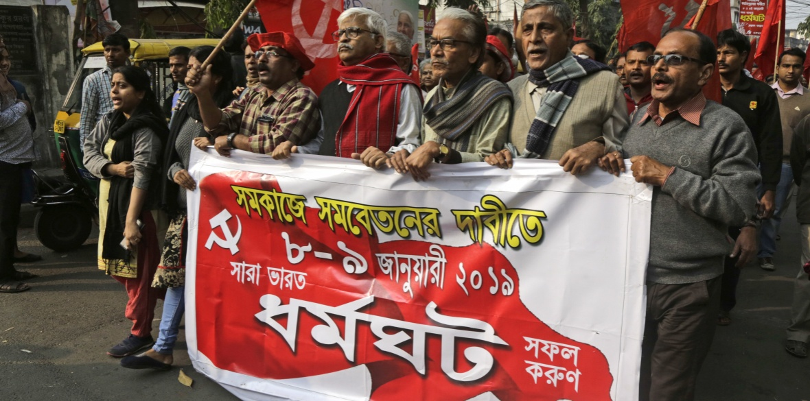 Communist Party of India-Marxist (CPI-M) supporters participate in a rally on the second day of a two-day general strike called by various trade unions in Kolkata