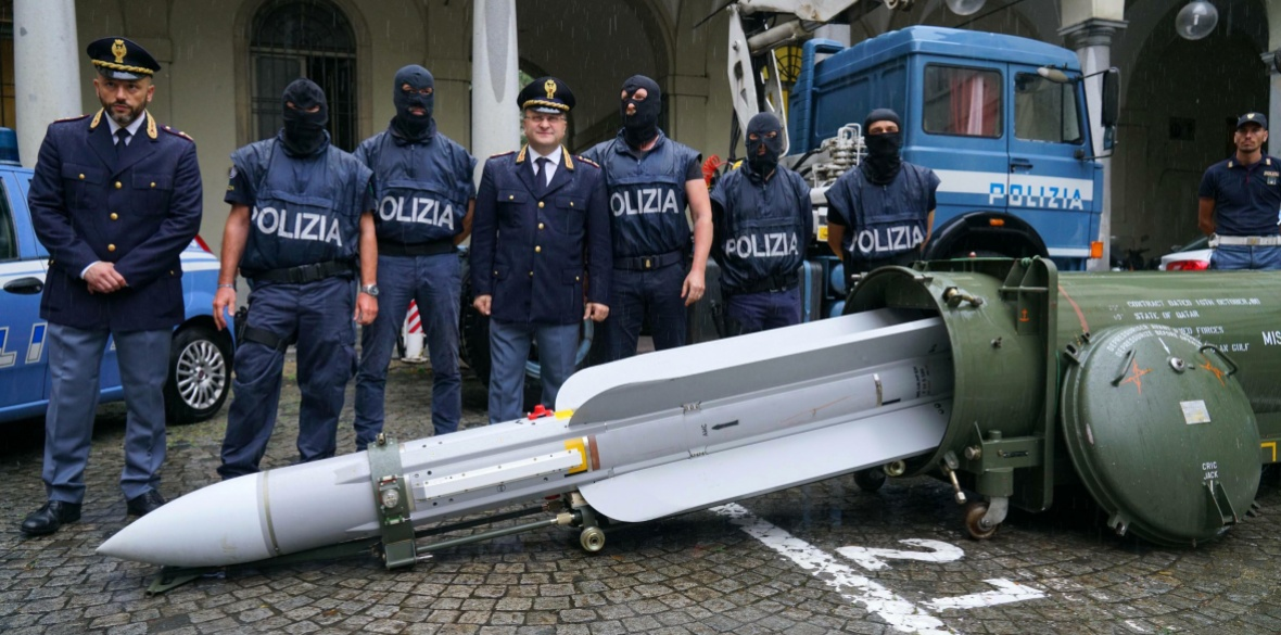 Police in northern Italy have detained three men, including one tied to a neo-fascist Italian political party, after uncovering a huge stash of automatic weapons, a missile and nazi propaganda