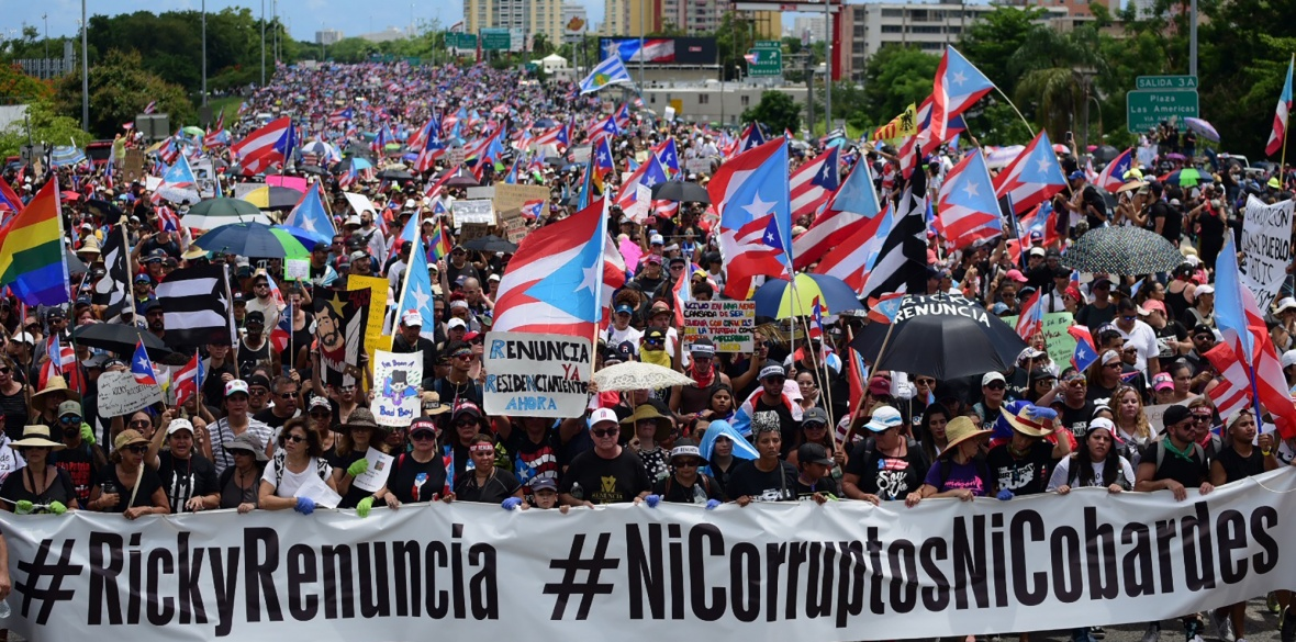 Thousands of Puerto Ricans gather for what many are expecting to be one of the biggest protests ever seen in the US colony