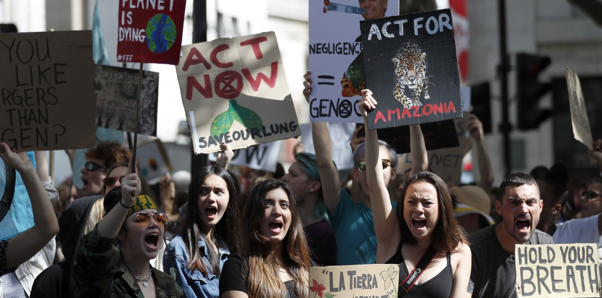 Extinction Rebellion activists protest outside the Brazilian Embassy in London, England against President Jair Bolsonaro's inaction on the fires ravaging the Amazon rainforest