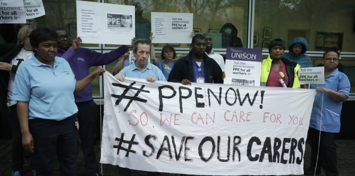 Hospital workers take part in a protest calling on the government to provide PPE across Britain for all workers in care, the NHS and other vital public services