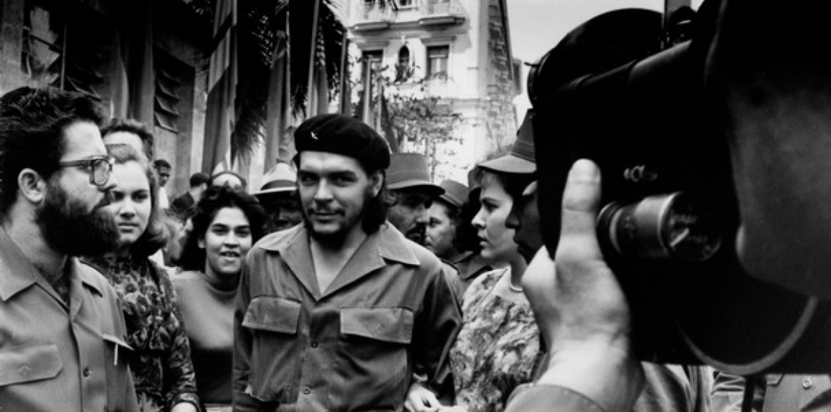 Ernesto 'Che' Guevara in 1960, walking through the streets of Havana with his wife Aleida (right)