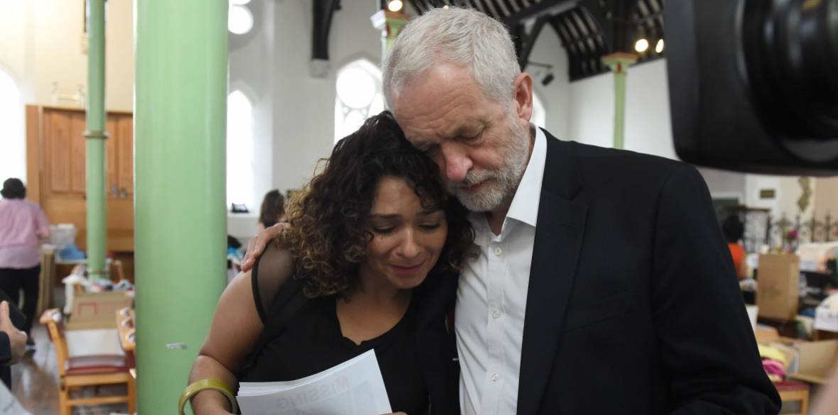 Jeremy Corbyn comforts a local resident last June at St Clement's Church in west London where volunteers provided shelter and support for people affected by the fire at Grenfell Tower