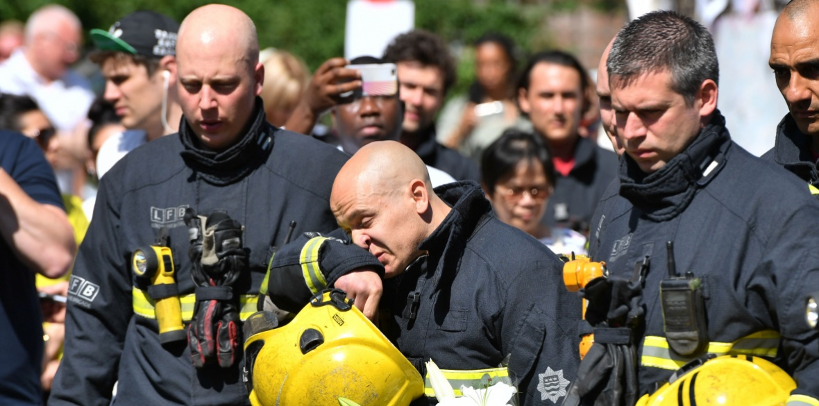 London, England firefighters during a minute's silence for the victims of the Grenfell Tower fire