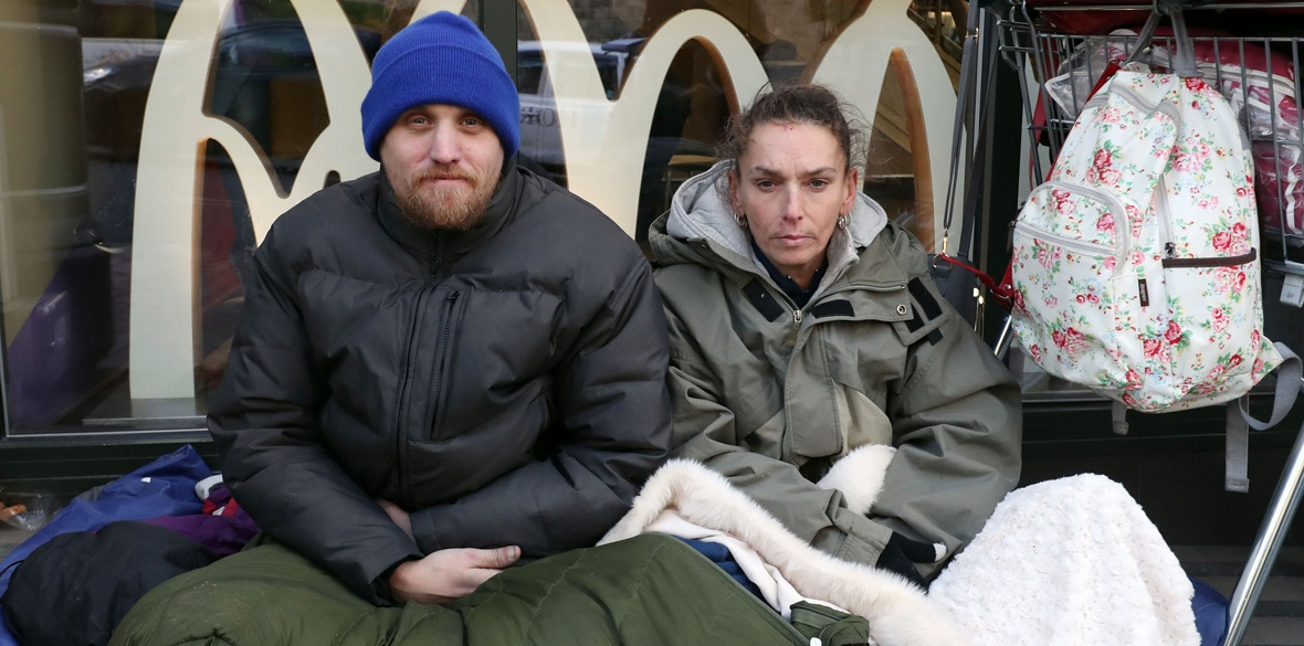 Homeless Britons James and Tracy with their possessions near Windsor Castle, Berkshire