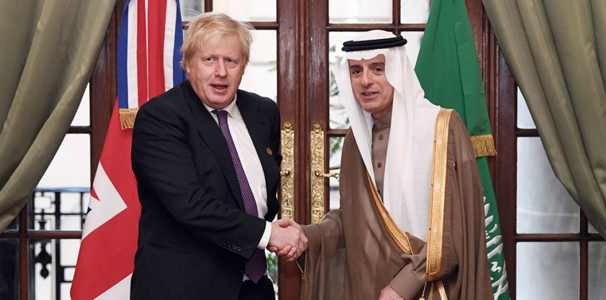 British Conservative Prime Minister Boris Johnson at a meeting with Saudi Arabia's foreign minister Adel al-Jubeir at the G20 Summit in 2018
