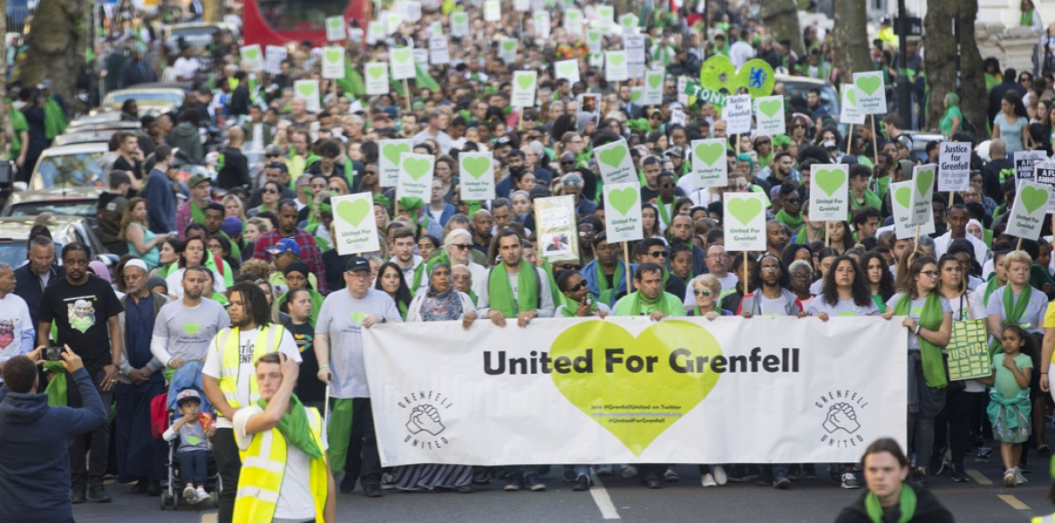 People take part in a silent walk by Grenfell Tower, London, to mark one year since the blaze which claimed 72 lives