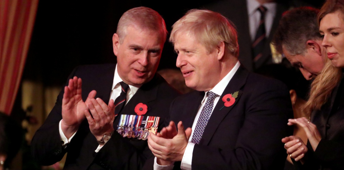 British Prince Andrew and Conservative Prime Minister Boris Johnson attend the annual Royal British Legion Festival of Remembrance at the Royal Albert Hall in Kensington in November 2019