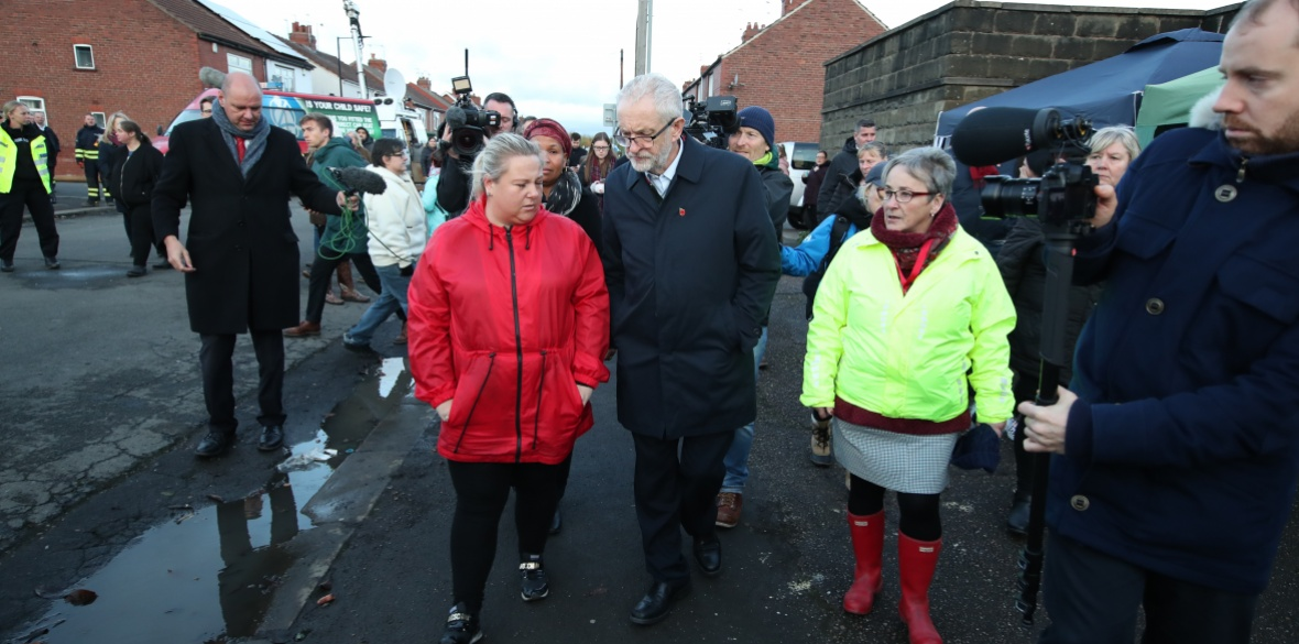 Labour Party leader Jeremy Corbyn talks to a resident in flooded Bentley, Doncaster