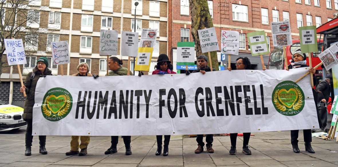 Protesters outside the Grenfell Tower public inquiry in London, where the second part of the inquiry into the Grenfell Tower fire, examining the circumstances and causes of the disaster, was due to start