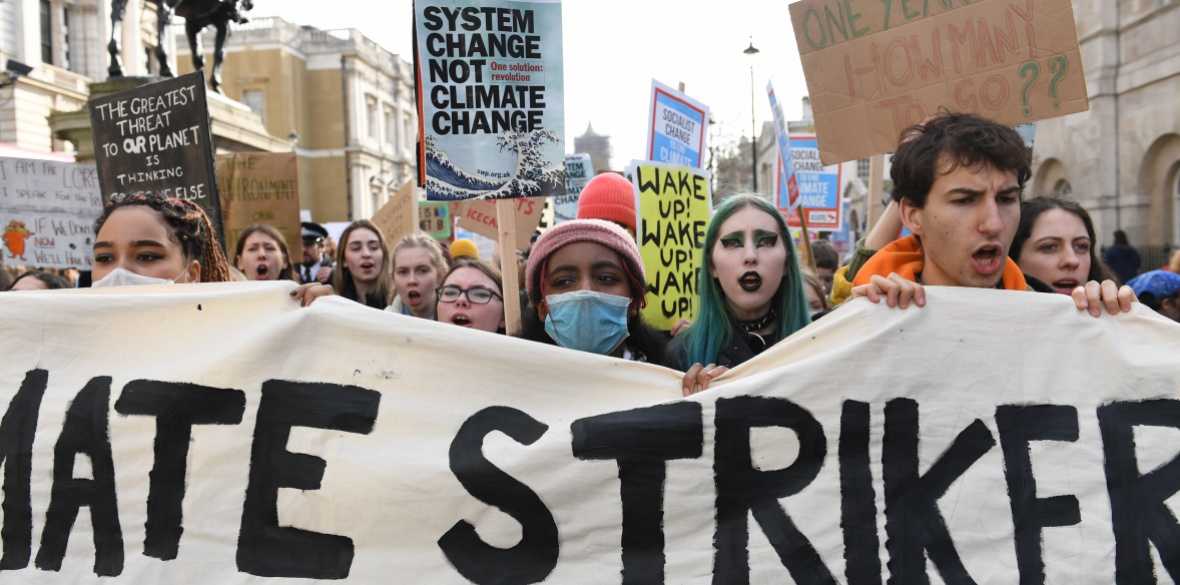 Climate change protesters march through Whitehall, London, England