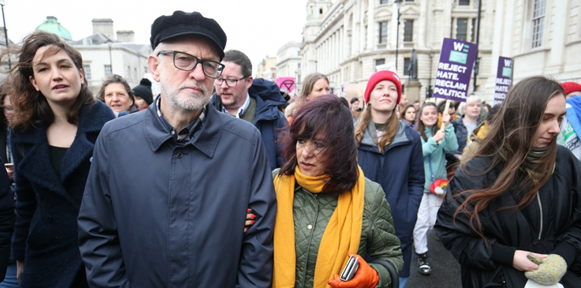 British Labour party leader Jeremy Corbyn and his wife Laura Alvarez marching on international women's day