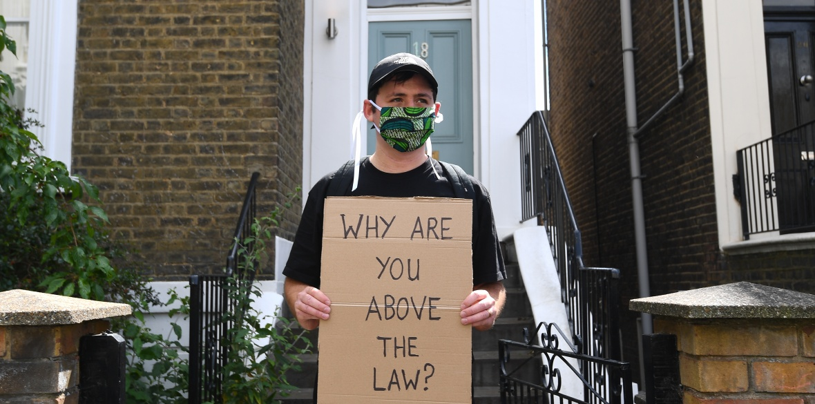 A protester outside the north London home of British Conservative Prime Minister Boris Johnson's senior aide Dominic Cummings, as lockdown questions continue to bombard the Government after it emerged that he travelled to his parents' home despite coronavirus-related restrictions