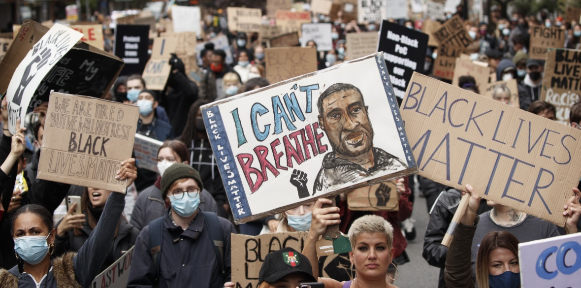People take part in a Black Lives Matter protest rally in Manchester, in memory of George Floyd who was killed on May 25 while in police custody in the US city of Minneapolis