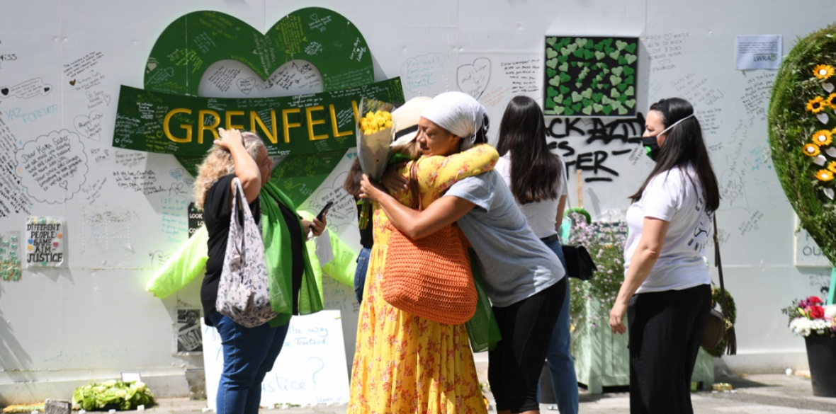 People at the Grenfell Memorial Community Mosaic at the base of the tower block in London, England on the third anniversary of the Grenfell Tower fire which claimed 72 lives on June 14 2017