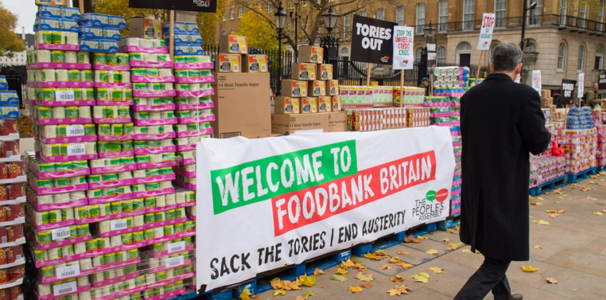 A People's Assembly protest where tins of food were stacked outside Downing Street 10 last year