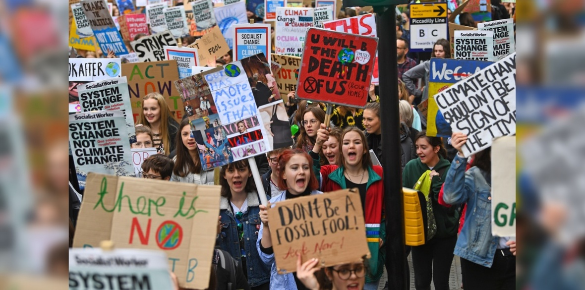 Students take part in a strike for the climate crisis outside Parliament Square, London, as demonstrations are planned in towns and cities across the UK as part of the YouthStrike4Climate movement