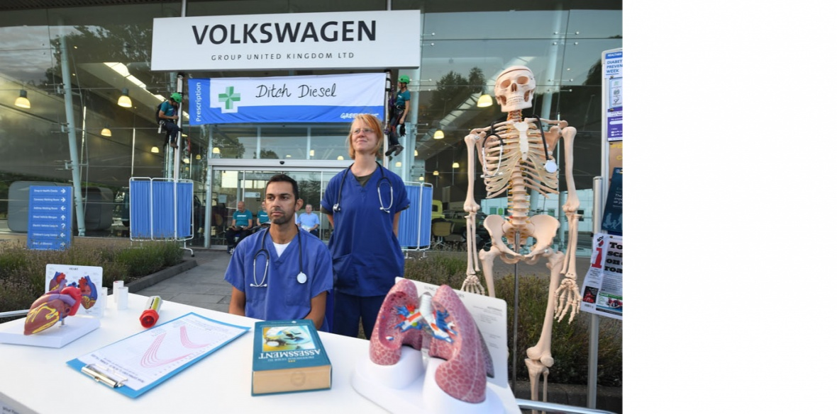 Air pollution campaigners and medical professionals barricaded entrances to the Volkswagen building in Milton Keynes, England and set up a mock clinic offering health advice to staff and members of the public