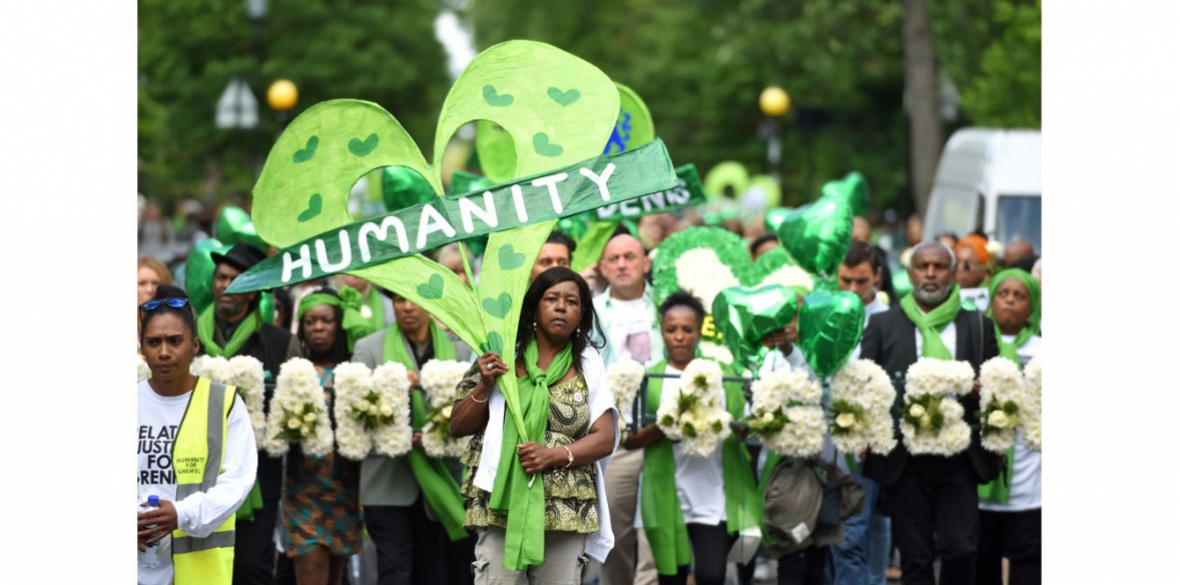 The procession after a Grenfell disaster memorial service was held at St Helen's church in London, England
