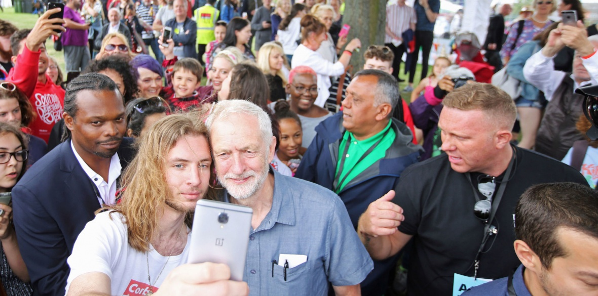 Jeremy Corbyn is met by supporters at the Labour Live event