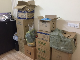Cardboard boxes stacked up in one of the rooms at the refugee camp