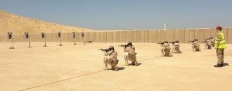 A British Army 'red cap' trains with the Bahraini King's elite Royal Guards