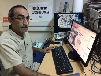 Evrensel editor Fatih Polat in the paper's Istanbul office