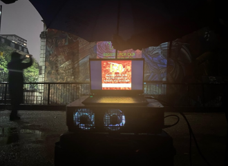 A film projection at the famous Cable Street mural in east London