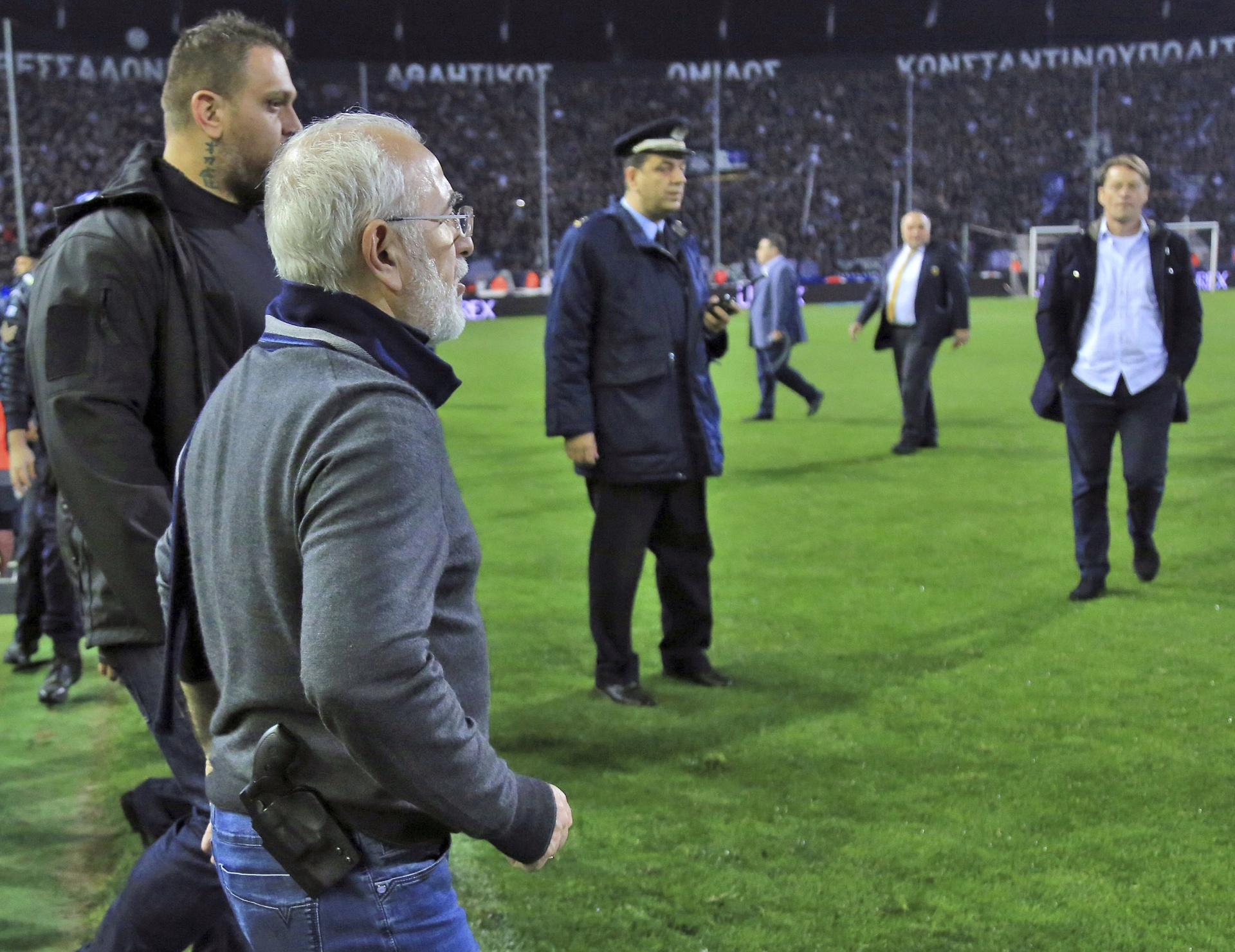 PAOK owner, businessman Ivan Savvidis invades, the pitch with a gun strapped to his hip